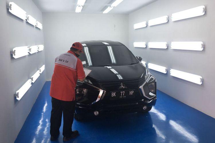 Proses finishing pada fasilitas perbaikan body dan cat Mitsubishi di Medan