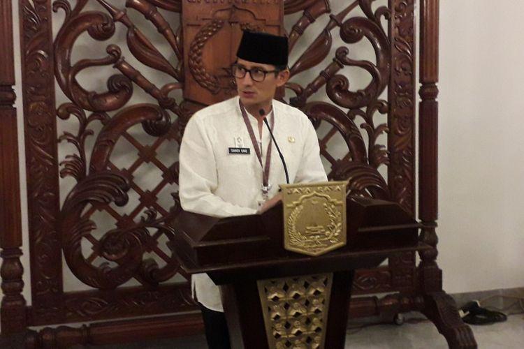 Wakil Gubernur DKI Jakarta Sandiaga Uno memberikan keterangan kepada wartawan di Balai Kota, Jakarta Pusat, Jumat (18/5/2018).