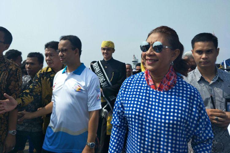 Menteri Kelautan dan Perikanan Susi Pudjiastuti bersama Gubernur DKI Jakarta Anies Baswedan menghadiri Festival Muara Baru, Sabtu (11/9/2018).