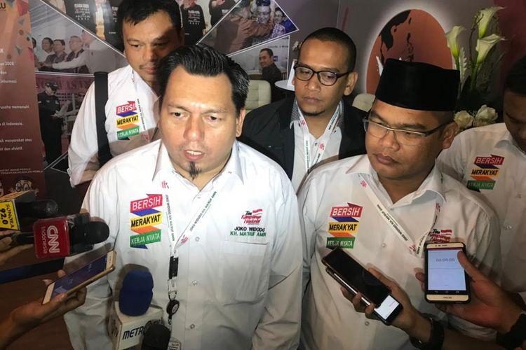 Direktur Hukum dan Advokasi Tim Kampanye Nasional Joko Widodo-Maruf Amin, Ade Irfan Pulungan saat mendatangi Bawaslu, Jakarta, Kamis (11/10/2018).