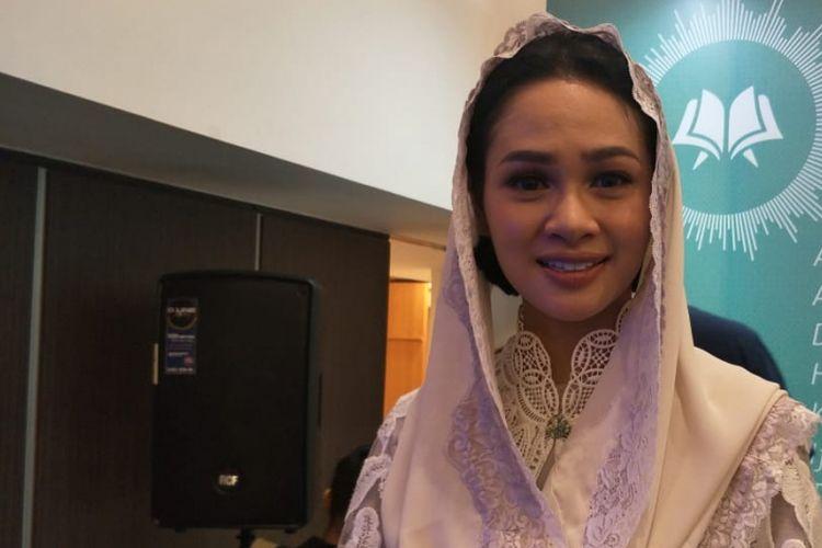 Andien saat ditemui usai jumpa pers peluncuran klip video Cahaya Dalam Sunyi di kawasan kuningan,  Jakarta Selatan, Rabu (6/6/2018).