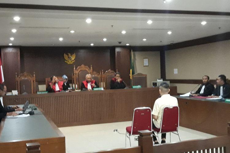 Anggota DPRD Sumatera Utara, Muhammad Faisal duduk di kursi terdakwa di Pengadilan Tipikor Jakarta, Rabu (20/2/2019).
