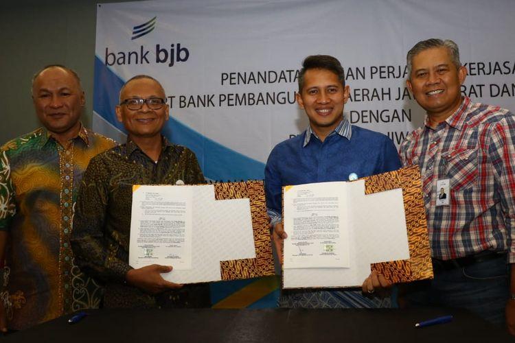 Penandatanganan kerja sama antara Bank BJB dengan PT Taspen di Bandung, akhir pekan lalu.