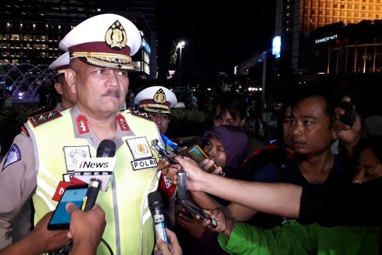 Kakorlantas Polri Irjen Pol Refdi Andri memberikan keterangab kepada wartawan di Bundaran HI, Jakarta Pusat, Senin (31/12/2018).