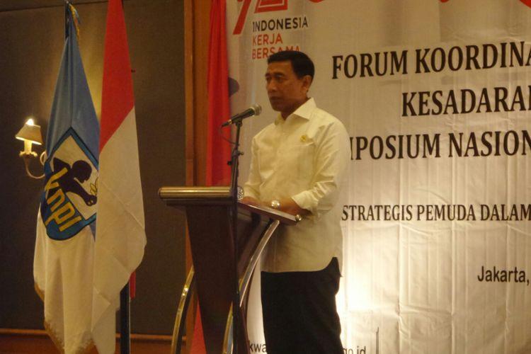 Menteri Koordinator Bidang Politik, Hukum dan Keamanan Wiranto saat menjadi pembicara Simposium Pemuda Nasional Indonesia, di Hotel Aryaduta, Jakarta Pusat, Rabu (30/8/2017).
