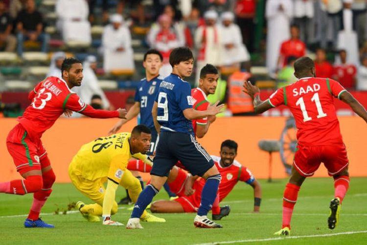 Timnas Jepang memastikan diri lolos ke babak 16 besar Piala Asia 2019 seusai meraih kemenangan tipis atas Oman dalam lanjutan laga Grup F, 13 Januari 2019.