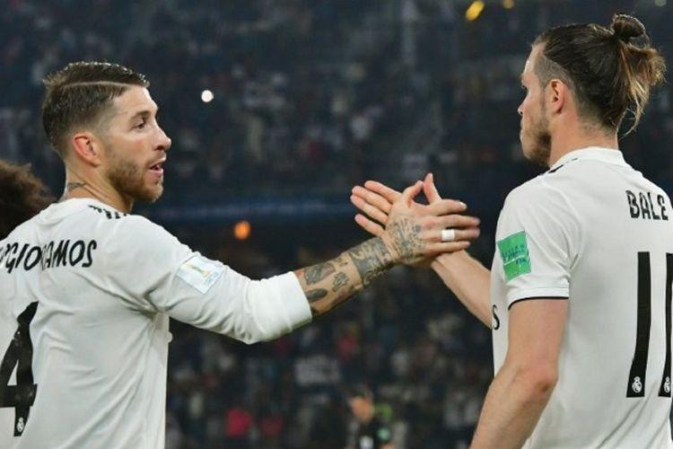 Gareth Bale merayakan golnya bersama Sergio Ramos pada pertandingan Real Madrid vs Kashima Antlers di Stadion  Zayed Sports City, Abu Dhabi, 19 Desember 2018.