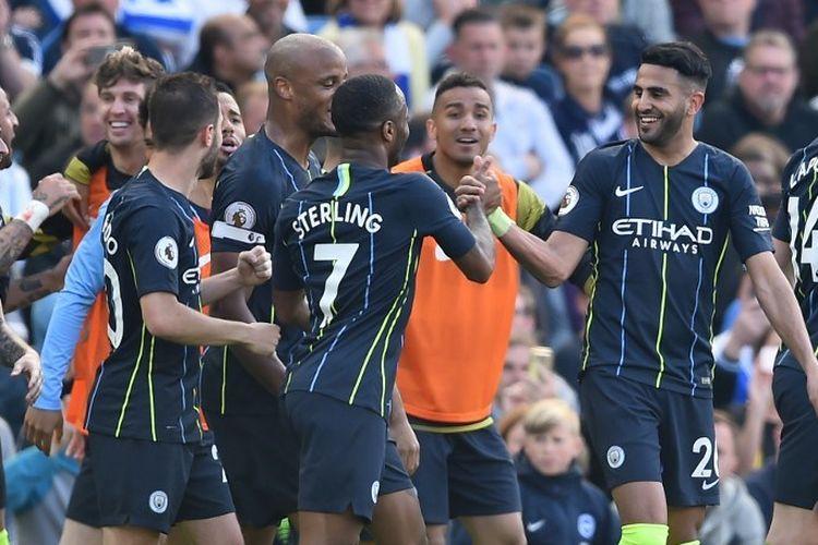 Para pemain Manchester City merayakan gol ke gawang Brighton & Hove Albion pada pertandingan Liga Ingrgis di Stadion American Express Community, 12 Mei 2019.