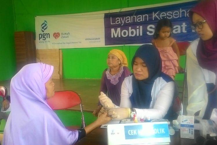 PGN memberi pelayanan kesehatan pada masyarakat di Kabupaten Musi Banyuasin, Selasa (10/7/2018)