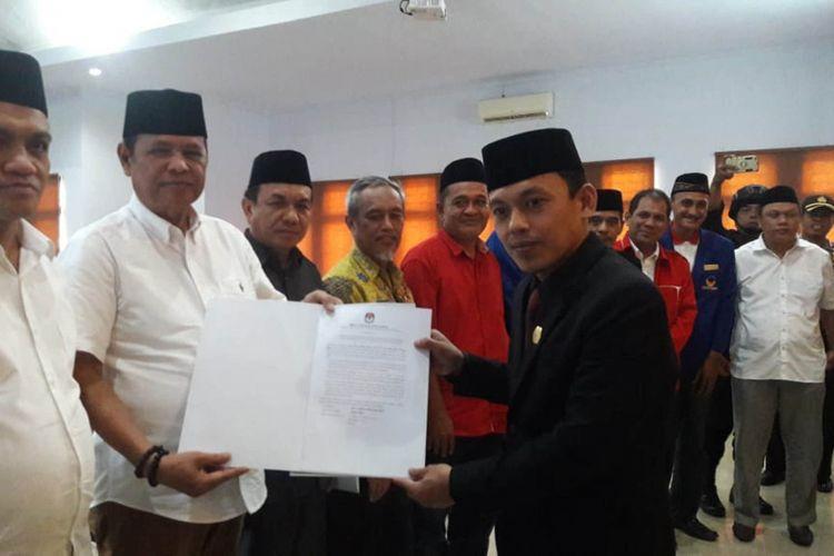 KPU Luwu menetapkan pasangan Basmin Mattayang - Syukur Bijak sebagai pemenang Pilkada Luwu 2018, Kamis (26/7/2018)