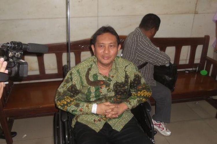 Mantan Kepala Dinas Perhubungan DKI Jakarta Udar Pristono saat tiba di Pengadilan Tindak Pidana Korupsi, Jakarta, Rabu (23/9/2015). Ia datang ke persidangan untuk menghadiri sidang pembacaan putusan dalam perkara pidana dugaan korupsi dan tindak pidana pencucian uang dalam proyek pengadaan bus transjakarta tahun 2012-2013.