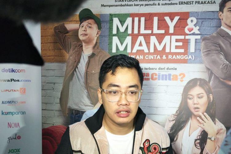 Dennis Adishwara saat jumpa pers dan screening film Milly & Mamet di XXI Epicentrum, Kuningan, Jakarta Selatan, Selasa (11/12/2018).