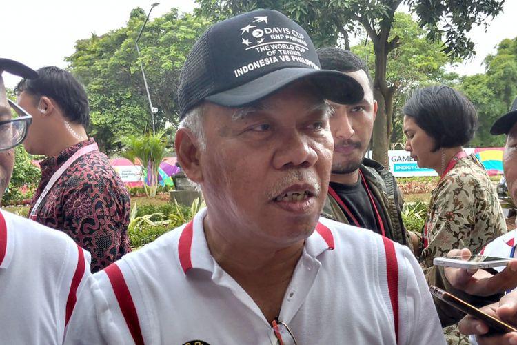 Menteri PUPR Basuk Hadimulyono usai mendampingi Presiden Joko Widodo meresmikan lapangan tenis indoor dan outdoor di Gelora Bung Karno, Jakarta, Sabtu (13/1/2018).