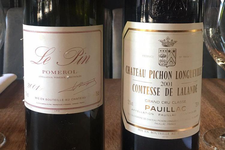 Botol anggur Chateau Pichon Longueville Comtesse de Lalande 2001 (kanan) dan botol Château Le Pin, Pomerol, 2001 (kiri).