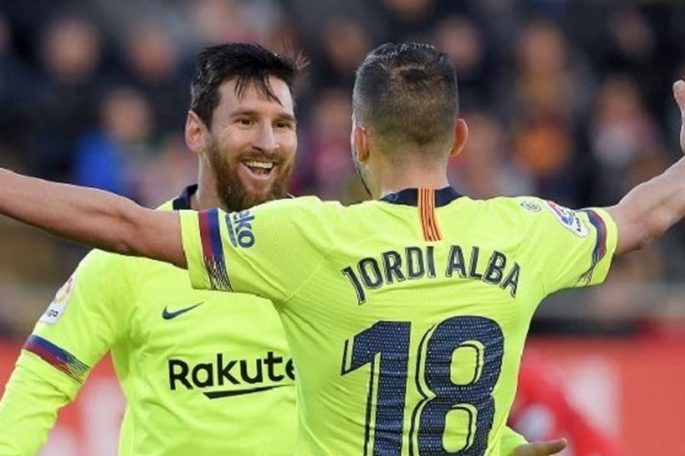 Jordi Alba merayakan gol Lionel Messi pada pertandingan Barcelona vs Girona di Stadion Montilivi dalam lanjutan La Liga Spanyol, 27 Januari 2019.