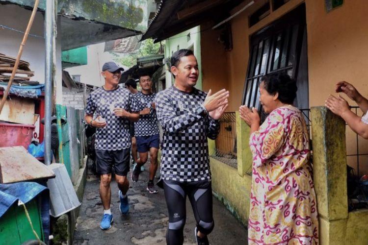 Bima Arya Sugiarto bersama sejumlah komunitas pelari menyusuri sejumlah titik untuk menyapa warga Bogor, Rabu (14/2/2018). Bima memanfaatkan hari pertama cuti sebagai Wali Kota Bogor dengan berlari.