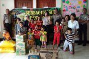 Senyuman Lepas Anak Yatim Piatu di Kupang untuk Polisi