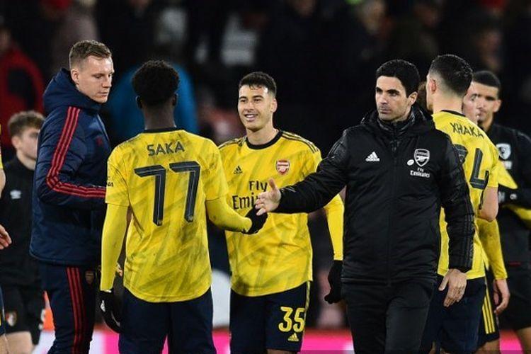 Mikel Arteta, Bukayo Saka, dan para pemain Arsenal merayakan kelolosan ke babak kelima Piala FA setelah mengalahkan Bournemouth.