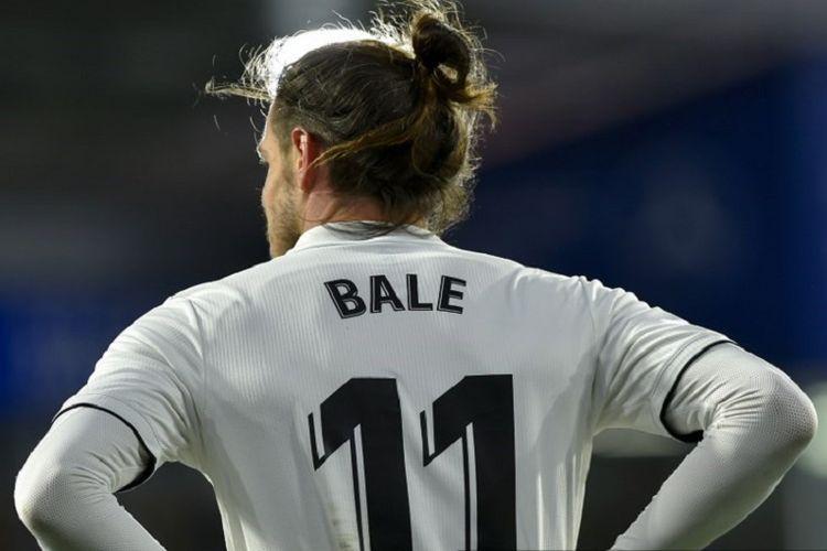 Gareth Bale tengah berkacak pinggang pada laga Real Madrid vs Huesca dalam lanjutan La Liga Spanyol, 9 Desember 2018.