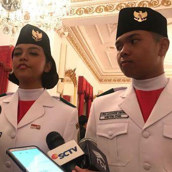 Pasangan Paskibraka perwakilan dari Provinsi Sumatera Utara Suci Izdihar Hulwa dan Lucas Alexiendre usai dikukuhkan Presiden Jokowi di Istana Negara, Rabu (15/8/2018).