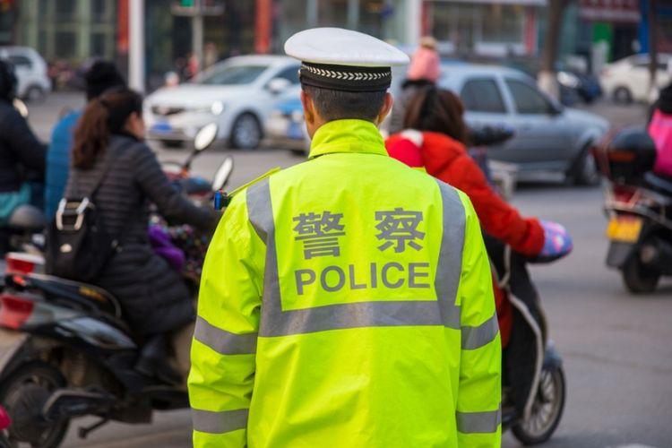 Ilustrasi petugas polisi China.