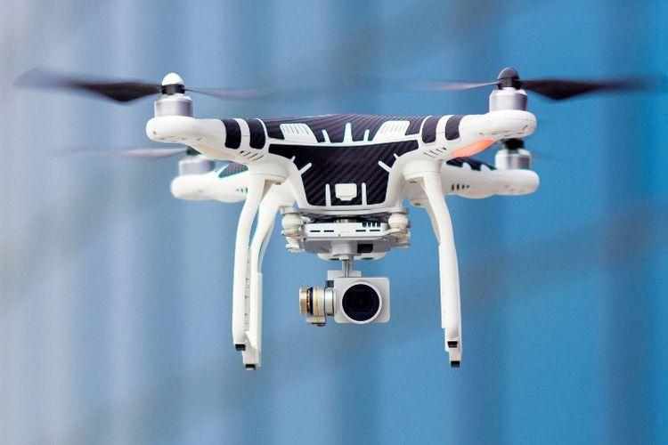 Ilustrasi drone yang dilengkapi kamera untuk merekam atau mengambil gambar.