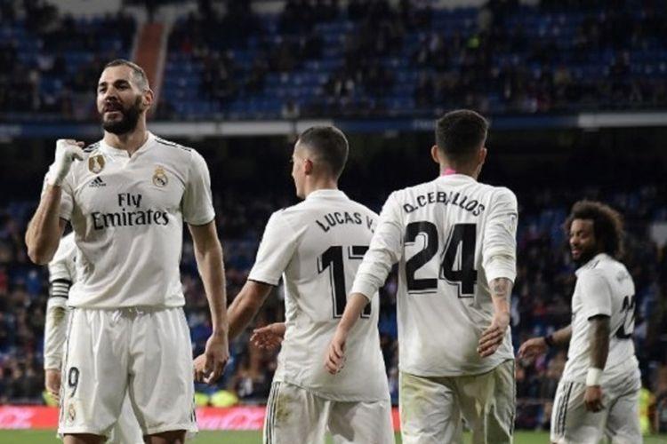 Karim Benzema merayakan golnya pada pertandingan Real Madrid vs Huesca dalam lanjutan La Liga Spanyol di Stadion Santiago Bernabeu, 31 Maret 2019.