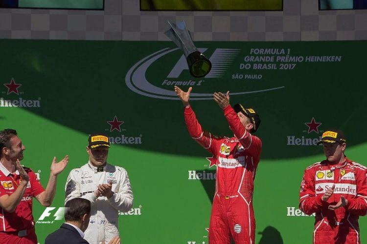 Sebastian Vettel memenangi GP Brasil setelah mengungguli Valtteri Bottas dan Kimi Raikkonen di Sao Paulo, Minggu (12/11/2017).