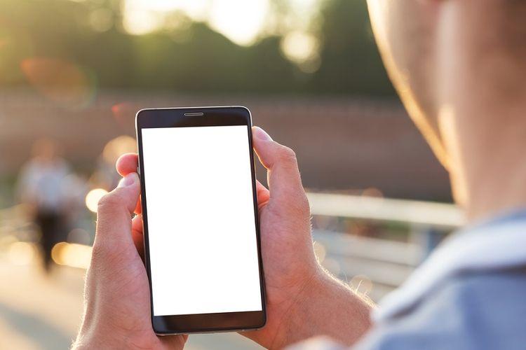 Ilustrasi seseorang menggunakan ponsel.