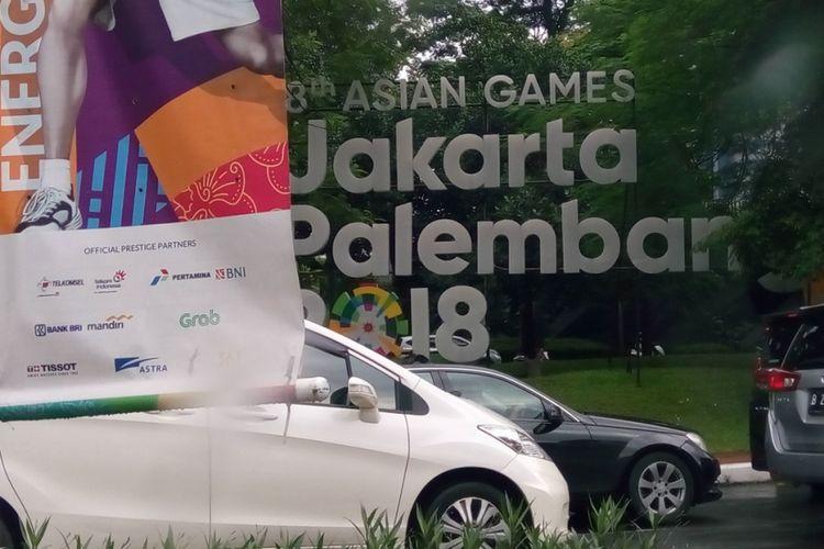 Baliho Asian Games ke-18 2018 di Jalan Jenderal Sudirman, Jakarta. Pada 1962, Indonesia menjadi tuan rumah Asian Games yang ke-4.