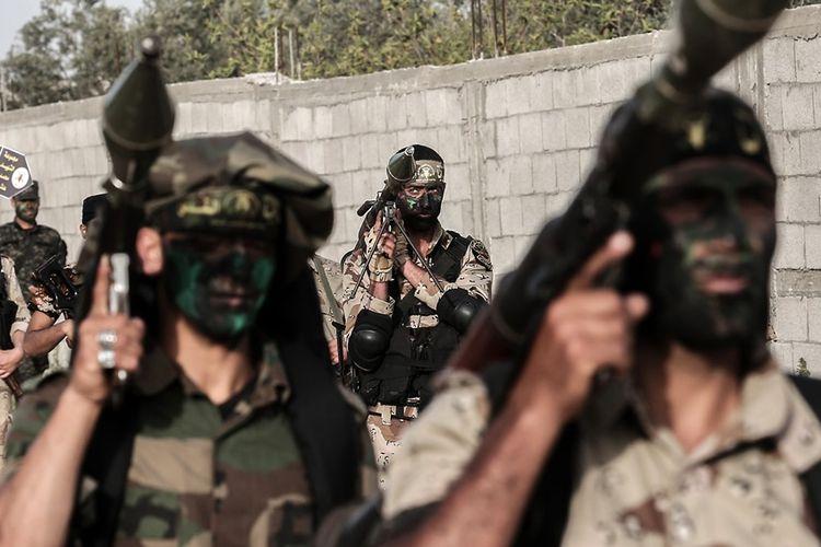 Anggota kelompok militan Jihad Islam Palestina (PIJ) saat latihan militer di Khan Yunis, selatan Jalur Gaza.