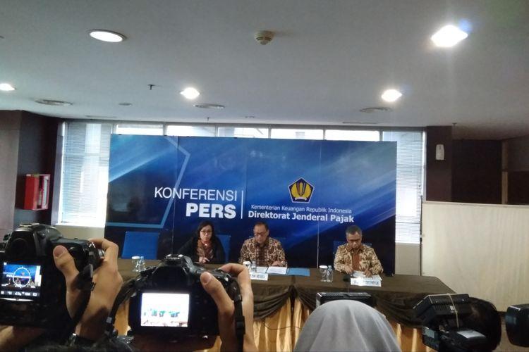 Menteri Keuangan Sri Mulyani, Gubernur Bank Indonesia Agus Martoeardojo, dan Ketua Dewan Komisioner OJK Wimboh Santoso saat melakukan Konferensi Pers di Gedung Direktorat Jenderal Pajak, Jumat (11/5/2018).