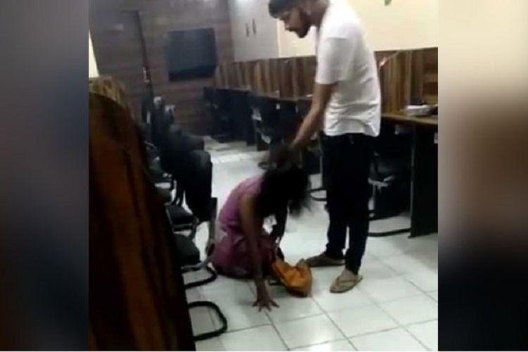Dalam video itu terlihat tersangka menyeret rambut perempuan itu dan membantingnya ke lantai.
