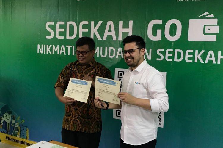 Deputi BAZNAS Arifin Purwakananta bersama Managing Director Go-Pay Budi Ganda Soebrata saat di kantor Baznas, Jakarta, Rabu (16/5/2018).