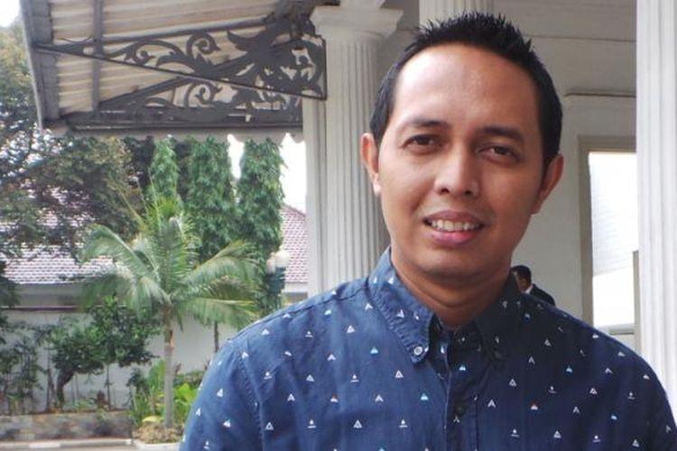 Pendiri lembaga survei Cyrus Network, Hasan Nasbi Batupahat, di Balai Kota.