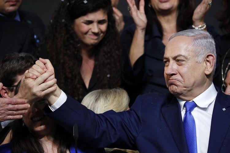 Perdana Menteri Israel Benjamin Netanyahu usai menyampaikan pidato di hadapan pendukungnya pada malam usai pemungutan suara dalam pemilu, Rabu (10/4/2019) dini hari.