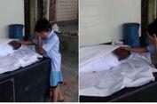 Fotonya Ratapi Jasad Sang Ayah Viral, Bocah Ini Dapat Bantuan Warganet