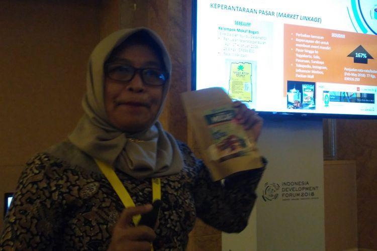 Kepala Dinas Koperasi dan UKM Kabupaten Pacitan, Eni Setyowati saat memaparkan perkembangan UKM di Pacitan di Hotel Ritz Carlton, Jakarta, Rabu (11/7/2018).