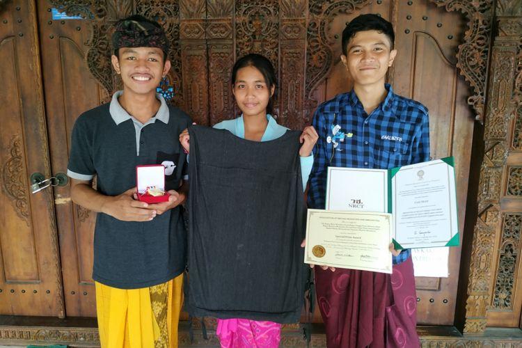 Siswa SMAN 3 Denpasar berhasil menciptakan rompi anti peluru dari serat tanaman gebang dan menyabet emas di ajang Thailand Inventor Day (TID)