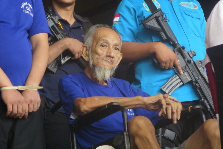 Ong Bok Seong (70) terpidana mati kasus narkoba yang menjadi pengendali peredaran narkoba dari Malaysia ke Indonesia saat dihadirkan dalam ungkap kasus di Mapolda Kalbar (14/3/2018).