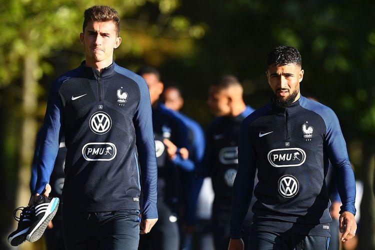 Dua pemain timnas Perancis, Aymeric Laporte dan Nabil Fekir, tiba di Clairefontaine-en-Yvelines dalam persiapan menghadapi laga internasional, 4 Oktober 2017.(AFP/Franck Fife)
