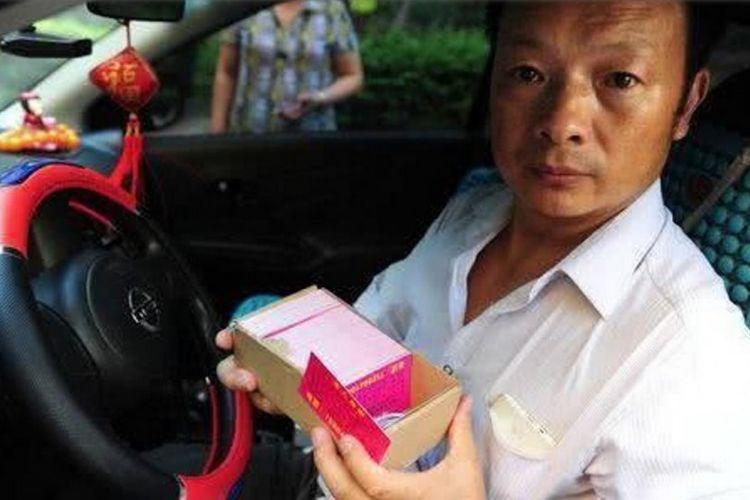 Wang Mingqing yang terus mencari putrinya selama 24 tahun.