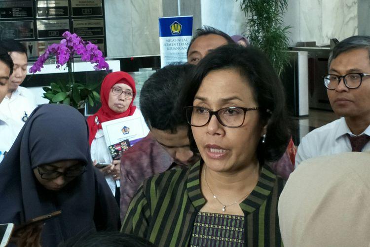 Menteri Keuangan Sri Mulyani Indrawati saat konferensi pers terkait penerbitan sukuk global di Kantor Kementerian Keuangan, Jakarta, Senin (26/2/2018).