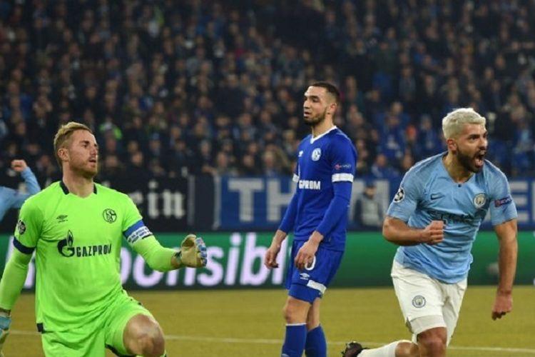Striker Manchester City Sergio Aguero berselebrasi setelah mencetak gol pada babak 16 besar Liga Champions antara Schalke 04 vs Manchester City pada 20 Februari 2019 di Gelsenkirchen, Jerman.