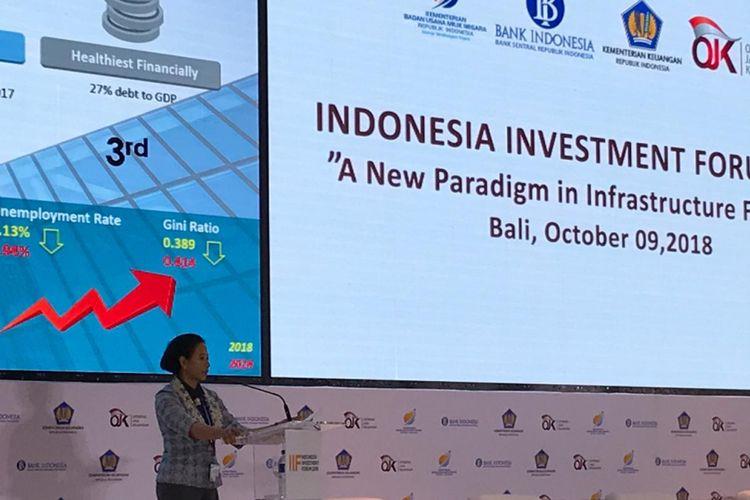 Menteri BUMN Rini Soemarno saat memberi keynote speech dalam Indonesia Investment Forum (IIF) 2018, salah satu acara dari rangkaian Pertemuan Tahunan IMF-Bank Dunia di Hotel Conrad, Tanjung Benoa, Bali, Selasa (9/10/2018).