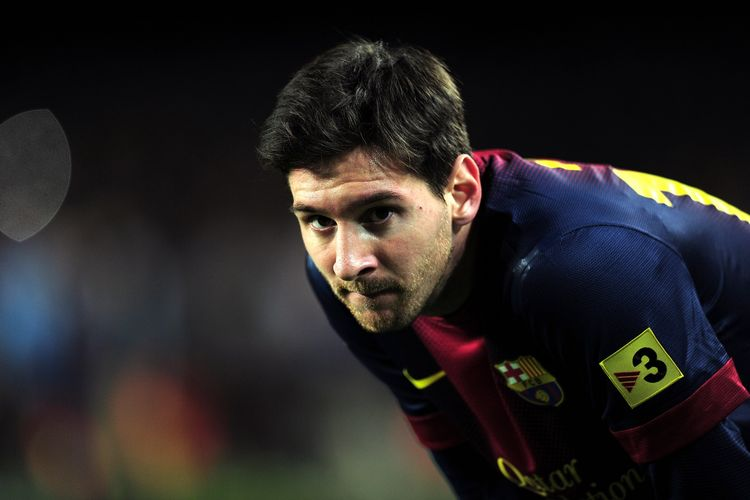 Lionel Messi saat memperkuat Barcelona melawan Atletico de Madrid dalam rangkaian laga Liga Spanyol di Camp Nou Stadium di Barcelona, pada 16 Desember 2012.