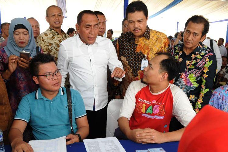 Penyerahan akad KPR massal PT Bank Tabungan Negara (Persero) Tbk di Medan, Senin (22/4/2019).