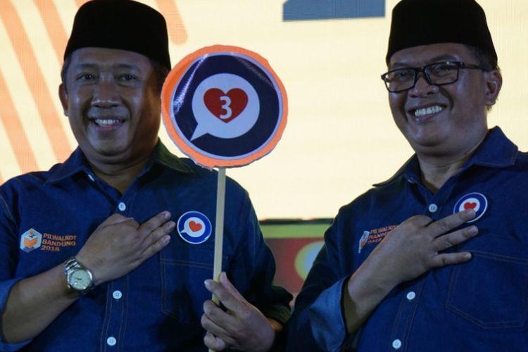 Pasangan Oded M Danial dan Yana Mulyana sesaat setelah pengumuman penetapan nomor urut pada Pilkada Kota Bandung, Selasa (13/2/2018).