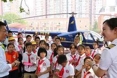 Kirim Helikopter ke Sekolah Anaknya, Pria China Dihujani Kritik