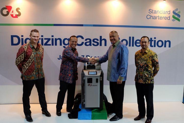 Peluncuruan Layanan Cash Deposit Machine, di Menara Standard Chartered Jakarta, Kamis (7/12/2017).